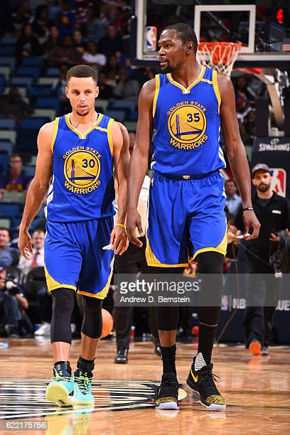 Stephen Curry and Kevin Durant of the Golden State Warriors look on during a game against the New Orleans Pelicans at Smoothie King Center on October...