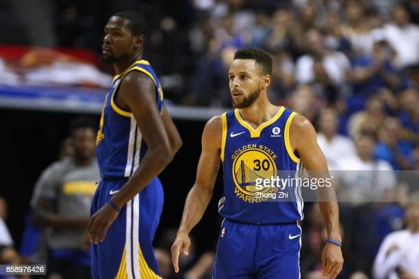 Stephen Curry and Kevin Durant of the Golden State Warriors look on during the game between the Minnesota Timberwolves and the Golden State Warriors...