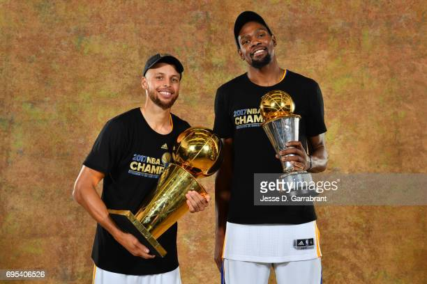 Stephen Curry and Kevin Durant of the Golden State Warriors poses for a portrait with the Larry O'Brien Trophy after defeating the Cleveland...