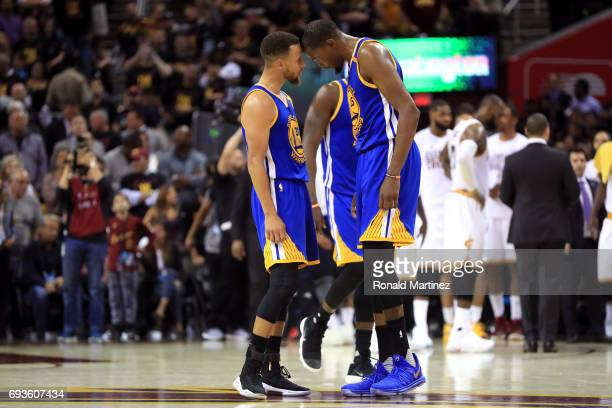 Stephen Curry and Kevin Durant of the Golden State Warriors react late in the game against the Cleveland Cavaliers in Game 3 of the 2017 NBA Finals...