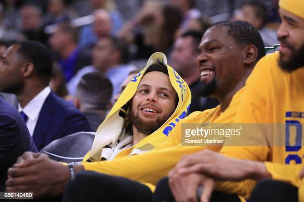 Stephen Curry and Kevin Durant of the Golden State Warriors react on the bench during the fourth quarter against the San Antonio Spurs during Game...
