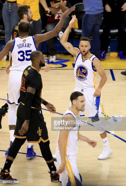 Stephen Curry and Kevin Durant of the Golden State Warriors react to a play against the Cleveland Cavaliers in Game 5 of the 2017 NBA Finals at...