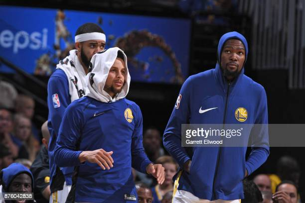 Stephen Curry and Kevin Durant of the Golden State Warriors react to a play during the game against the Denver Nuggets on November 4 2017 at the...