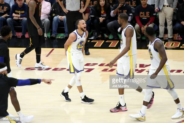 Stephen Curry and Kevin Durant of the Golden State Warriors react to a play in Game Three of the 2018 NBA Finals against the Cleveland Cavaliers on...