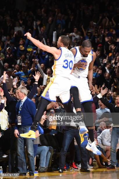 Stephen Curry and Kevin Durant of the Golden State Warriors reacts to a play against the LA Clippers during the game on February 23 2017 at ORACLE...