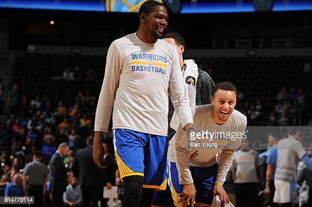 Stephen Curry and Kevin Durant of the Golden State Warriors smile during a preseason game against the Denver Nuggets on October 14 2016 at the Pepsi...