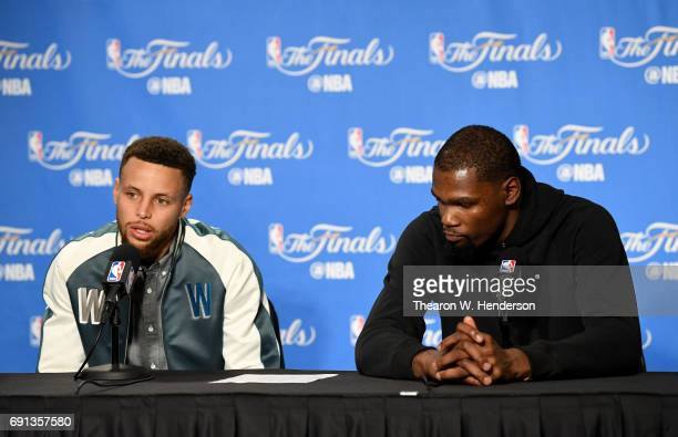 Stephen Curry and Kevin Durant of the Golden State Warriors speak to members of the press following Game 1 of the 2017 NBA Finals at ORACLE Arena on...