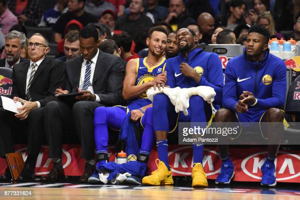 Stephen Curry and Kevin Durant of the Golden State Warriors talk during the game against the LA Clippers on October 30 2017 at STAPLES Center in Los...