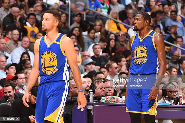 Stephen Curry and Kevin Durant of the Golden State Warriors walk off the court against the Los Angeles Lakers on November 4 2016 at STAPLES Center in...