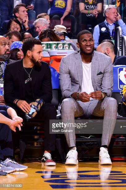 Stephen Curry and Kevon Looney of the Golden State Warriors look on against the Boston Celtics on November 15 2019 at Chase Center in San Francisco...