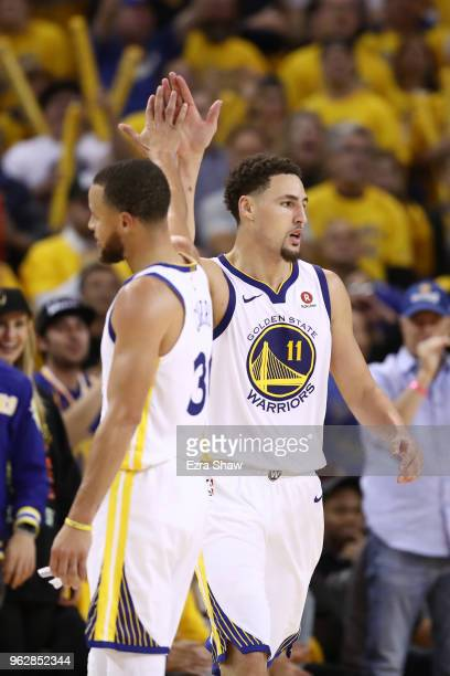 Stephen Curry and Klay Thompson of the Golden State Warriors celebrate after a play against the Houston Rockets during Game Six of the Western...
