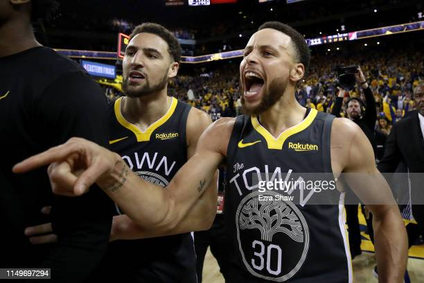 Stephen Curry and Klay Thompson of the Golden State Warriors celebrate after defeating the Portland Trail Blazers 114-111 in game two of the NBA...