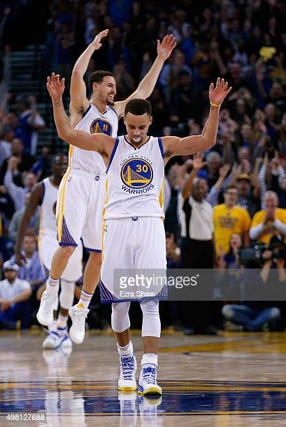 Stephen Curry and Klay Thompson of the Golden State Warriors celebrate after Harrison Barnes made a threepoint basket late in the fourth quarter of...