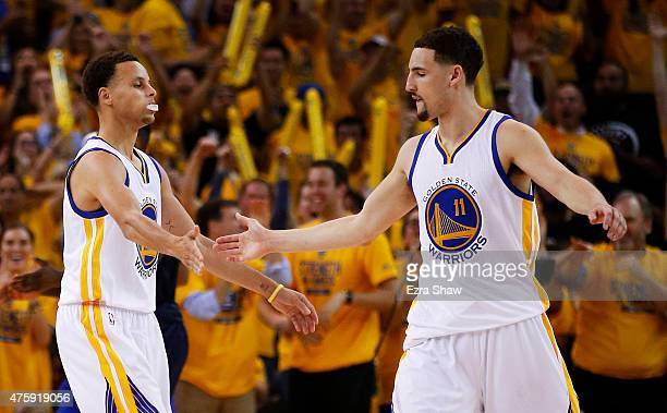 Stephen Curry and Klay Thompson of the Golden State Warriors celebrate in the second quarter against the Cleveland Cavaliers during Game One of the...