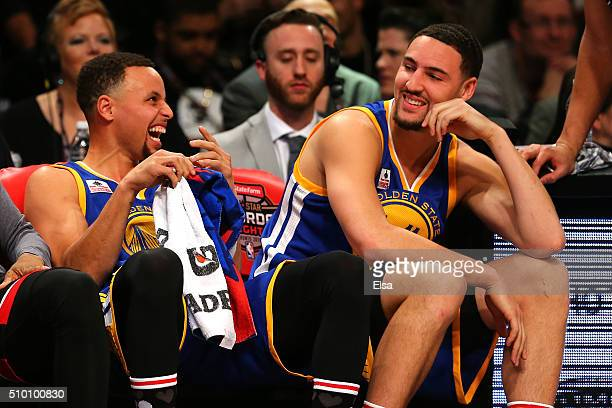 Stephen Curry and Klay Thompson of the Golden State Warriors laugh on the bench in the Foot Locker ThreePoint Contest during NBA AllStar Weekend 2016...