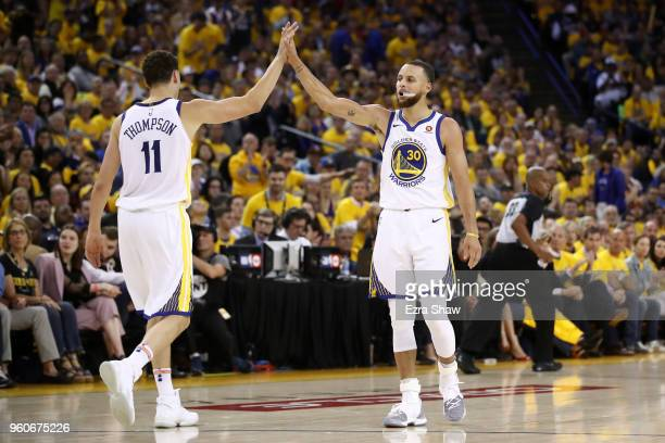 Stephen Curry and Klay Thompson of the Golden State Warriors react after a plat against the Houston Rockets during Game Three of the Western...