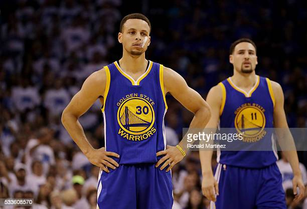 Stephen Curry and Klay Thompson of the Golden State Warriors react in the second quarter against the Oklahoma City Thunder in game three of the...