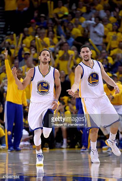 Stephen Curry and Klay Thompson of the Golden State Warriors reacts after Curry hit a jump shot against the New Orleans Pelicans in the fourth...