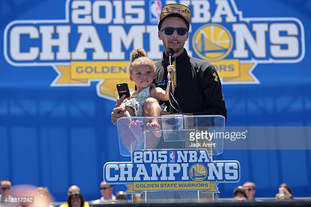 Stephen Curry and of the Golden State Warriors attends the Victory Parade And Rally with his daughter Riley Curry on June 19 2015 in Oakland CA NOTE...