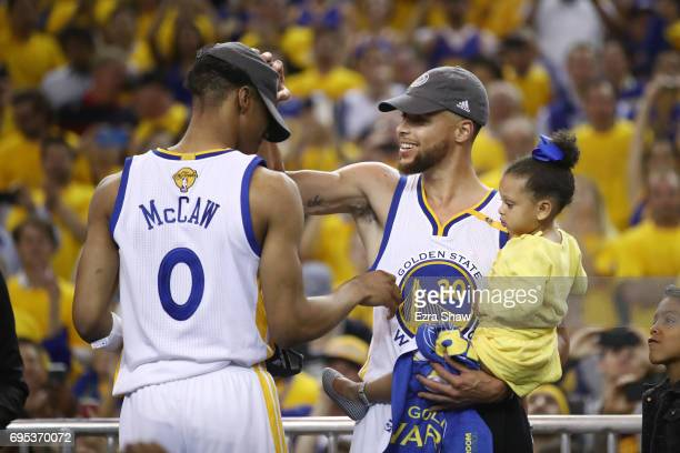 Stephen Curry and Patrick McCaw of the Golden State Warriors celebrate after defeating the Cleveland Cavaliers 129120 in Game 5 to win the 2017 NBA...