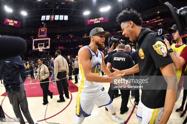 Stephen Curry and Quinn Cook of the Golden State Warriors exchange handshakes after defeating the Cleveland Cavaliers in Game Four of the 2018 NBA...