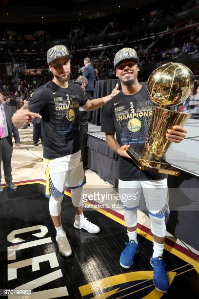 Stephen Curry and Quinn Cook of the Golden State Warriors pose with the Larry O'Brien Championship Trophy after Game Four of the 2018 NBA Finals...