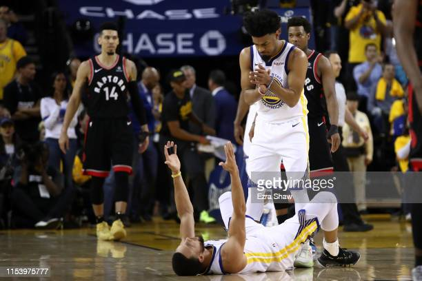 Stephen Curry and Quinn Cook of the Golden State Warriors react against the Toronto Raptors in the second half during Game Three of the 2019 NBA...