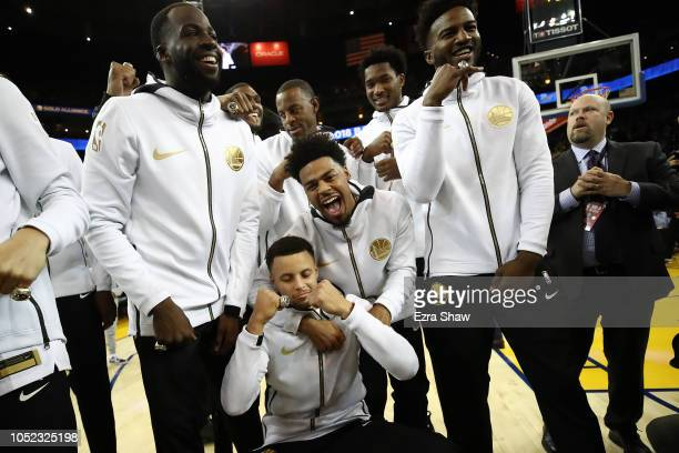 Stephen Curry and the Golden State Warriors celebrate after receiving their 20172018 Championship rings prior to their game against the Oklahoma City...