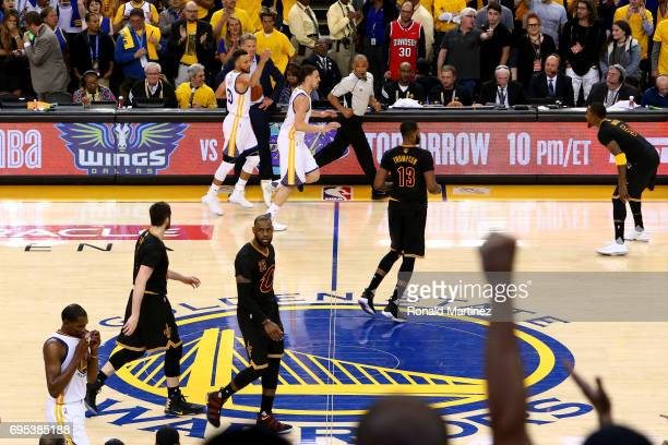 Stephen Curry and the Golden State Warriors celebrates in the final moments of their win over the Cleveland Cavaliers in Game 5 to win the 2017 NBA...