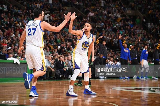 Stephen Curry and Zaza Pachulia of the Golden State Warriors celebrate during a game against the Boston Celtics on November 18 2016 at TD Garden in...