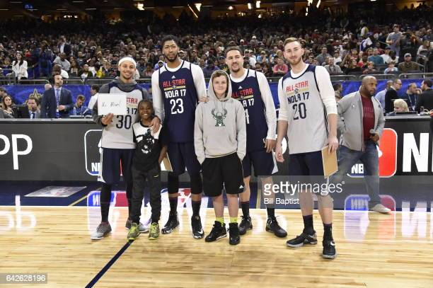 Stephen Curry Anthony Davis Klay Thompson and Gordon Hayward of the Western Conference participate in a game with fans during the 2017 NBA AllStar...