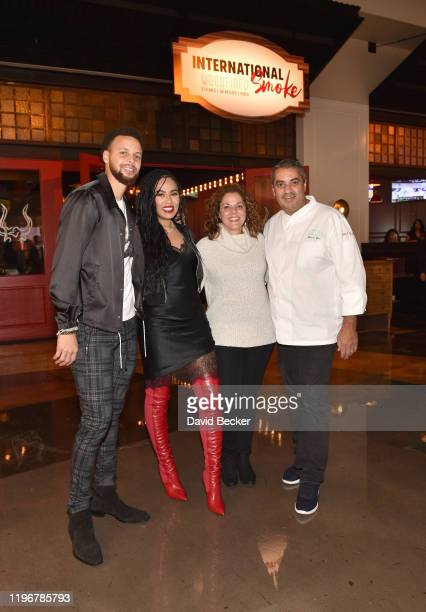 Stephen Curry Ayesha Curry Diane Mina and Michael Mina attend the opening of International Smoke Las Vegas at MGM Grand Hotel Casino on December 30...