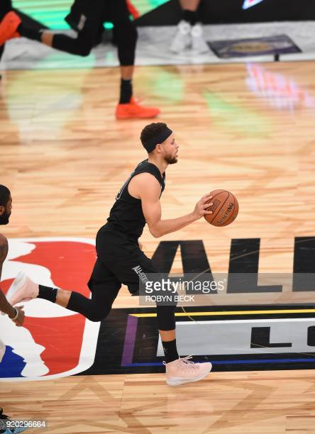 Stephen Curry brings the ball up court during the 2018 NBA AllStar Game February 18 2018 at Staples Center in Los Angeles California / AFP PHOTO /...