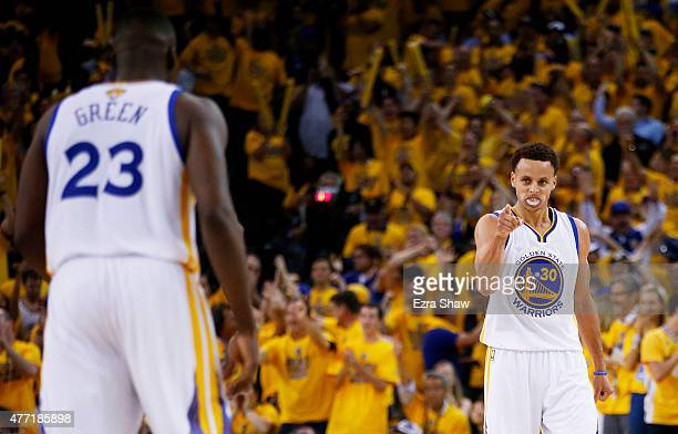 Stephen Curry celebrates with Draymond Green of the Golden State Warriors in the fourth quarter against the Cleveland Cavaliers during Game Five of...