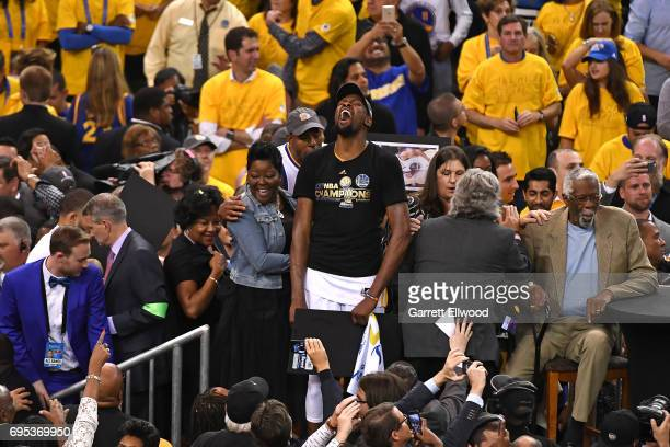 Stephen Curry celebrates with Kevin Durant of the Golden State Warriors after the Warriors defeated the Cleveland Cavaliers in Game Five of the 2017...