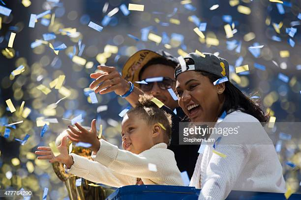 Stephen Curry daughter Riley Curry and wife Ayesha Curry celebrate as confetti falls during the Golden State Warriors Victory Parade in Oakland...