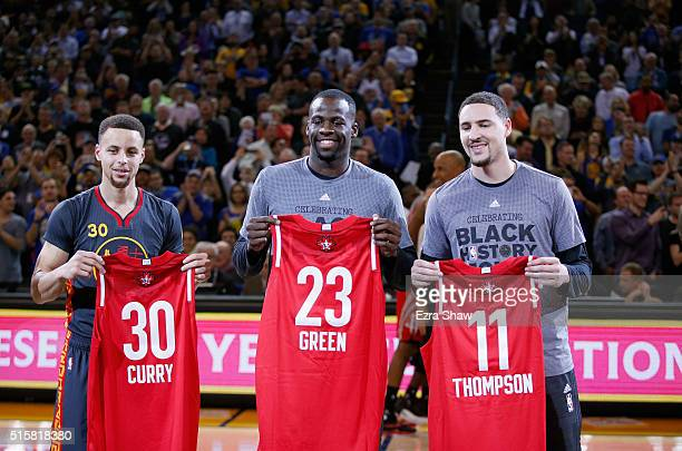 Stephen Curry Draymond Green and Klay Thompson of the Golden State Warriors hold up their respective AllStar jerseys before their game against the...