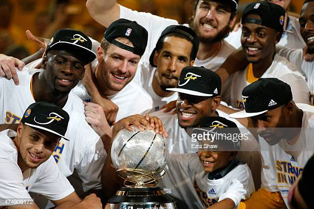 Stephen Curry Draymond Green David Lee Shaun Livingston Andre Iguodala and the Golden State Warriors celebrate the Warriors 10490 victory against the...