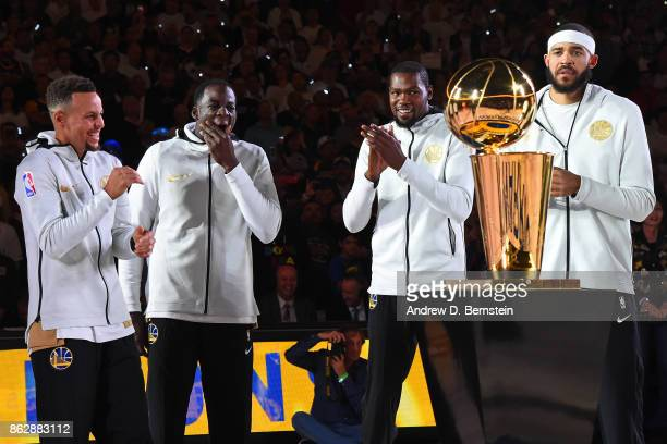 Stephen Curry Draymond Green Kevin Durant and JaVale McGee smile and laugh during the Golden State Warriors ring ceremony before the game against the...