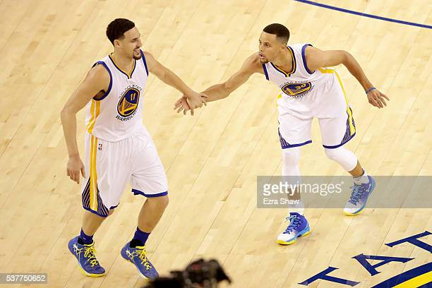 Stephen Curry gives teammate Klay Thompson of the Golden State Warriors a five in the fourth quarter against the Cleveland Cavaliers in Game 1 of the...