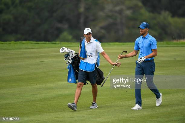 Stephen Curry hands his club to his caddy Jonnie West during the first round of the Webcom Tour Ellie Mae Classic at TPC Stonebrae on August 3 2017...