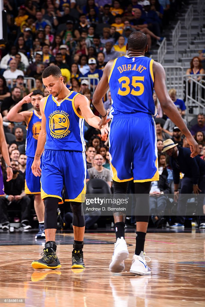 b434bd18474a Stephen Curry high fives Kevin Durant of the Golden State Warriors ...
