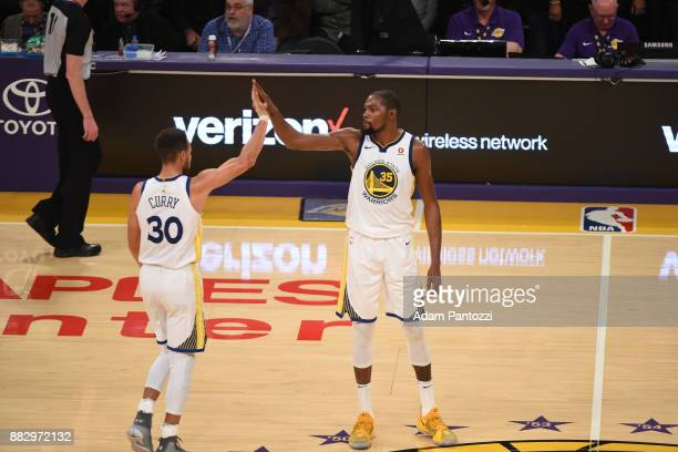 Stephen Curry high fives Kevin Durant of the Golden State Warriors during the game against the Los Angeles Lakers on November 29 2017 at STAPLES...