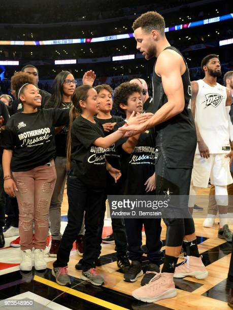 Stephen Curry high fives kids during the NBA AllStar Game as a part of 2018 NBA AllStar Weekend at STAPLES Center on February 18 2018 in Los Angeles...
