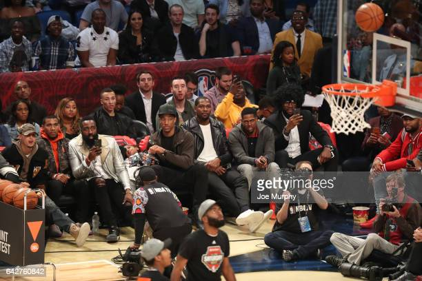 Stephen Curry James Harden DeMar DeRozan Kevin Durant and LeBron James watch the JBL ThreePoint Contest during State Farm AllStar Saturday Night as...