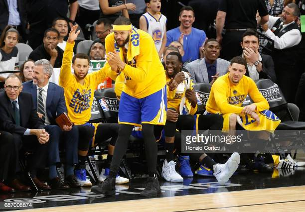 Stephen Curry JaVale McGee Draymond Green and Klay Thompson of the Golden State Warriors react on the bench in the second half against the San...