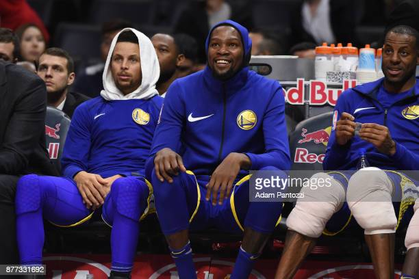 Stephen Curry Kevin Durant and Andre Iguodala of the Golden State Warriors looks on during the game against the LA Clippers on October 30 2017 at...