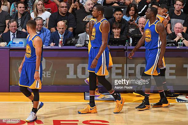 Stephen Curry Kevin Durant and Draymond Green of the Golden State Warriors walk on the court during the game against the Los Angeles Lakers on...