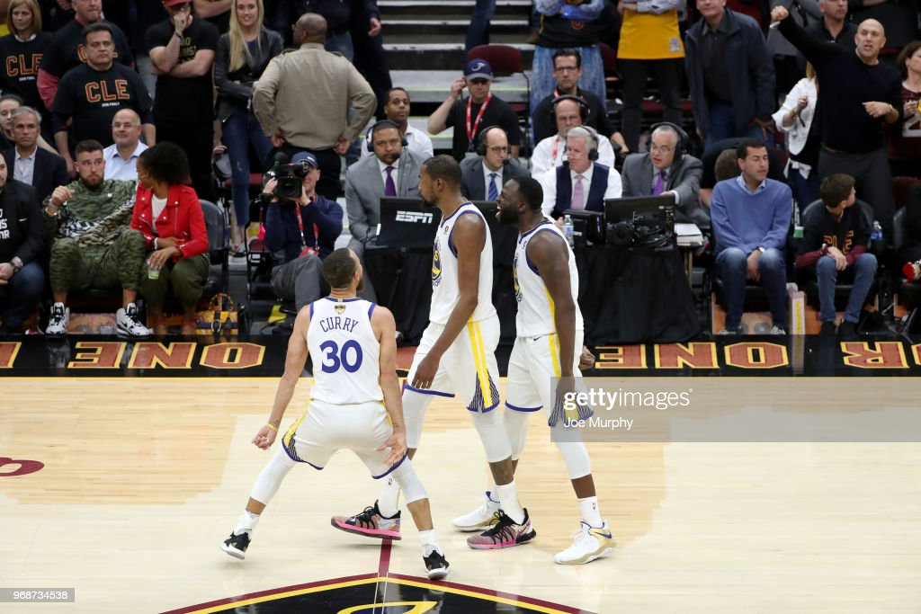 Stephen Curry #30, Kevin Durant #35, and Draymond Green #23 of the Golden State Warriors react to a play in Game Three of the 2018 NBA Finals against the Cleveland Cavaliers on June 6, 2018 at Quicken Loans Arena in Cleveland, Ohio.
