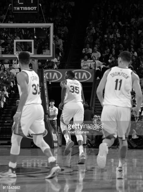 Stephen Curry Kevin Durant and Klay Thompson of the Golden State Warriors during the game against the New York Knicks on January 23 2018 at ORACLE...